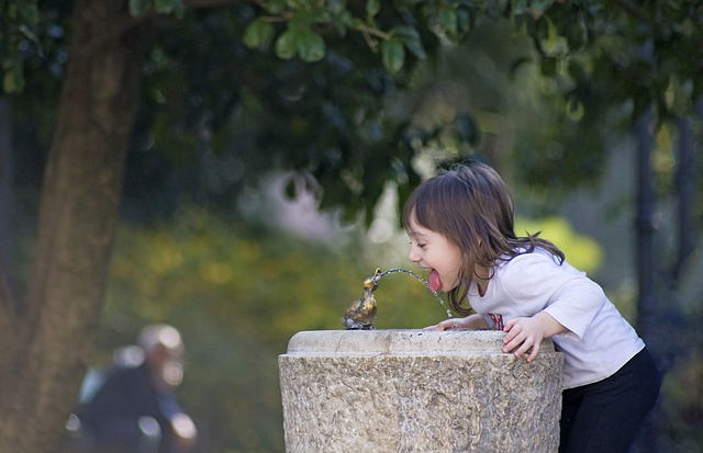 Child at water fountain